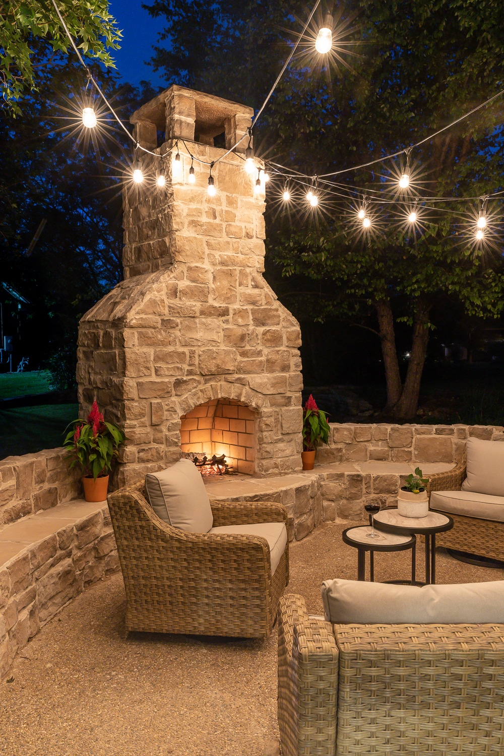 Outdoor fireplace with curved bench seating