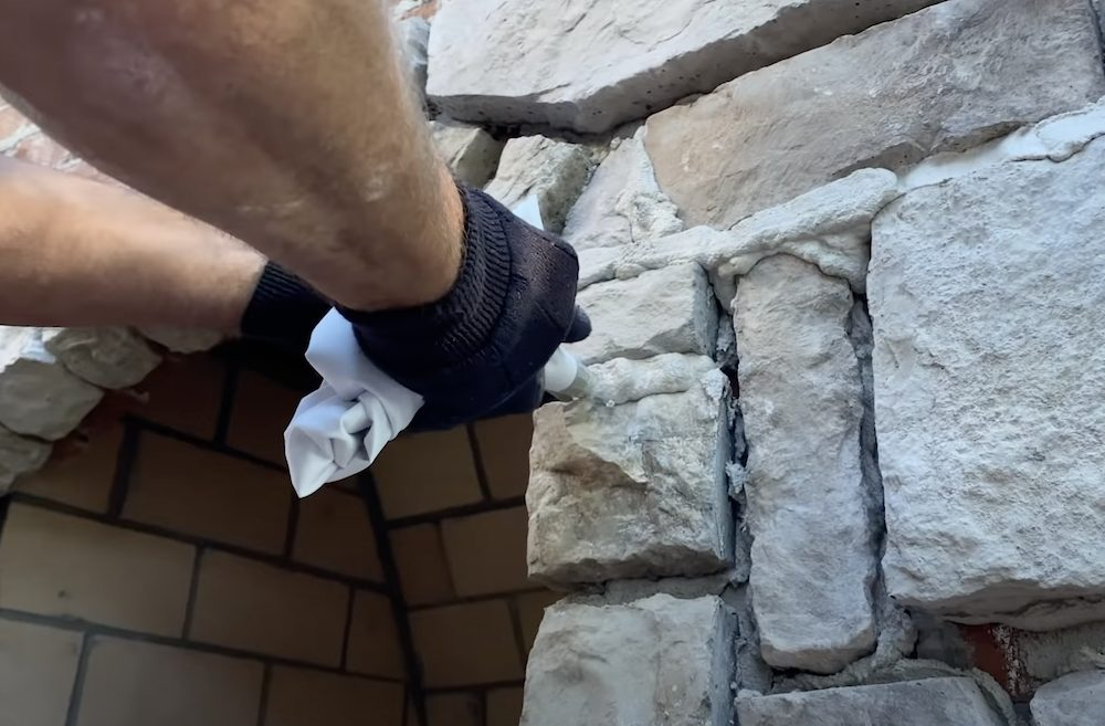 Over-grouting technique for stone veneer
