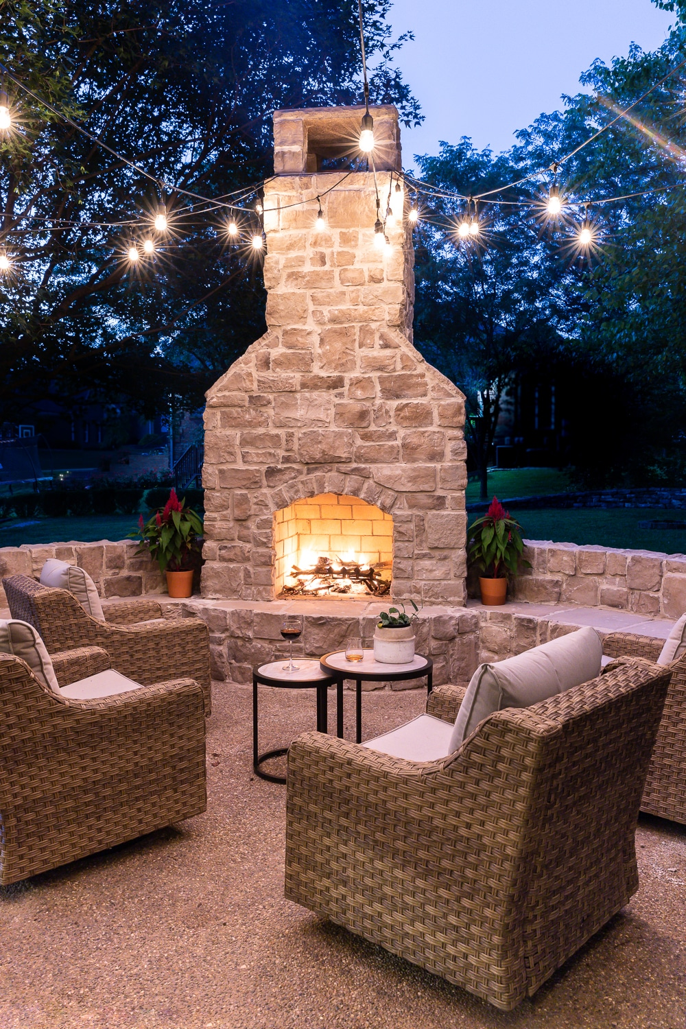 Gorgeous outdoor fireplace on a curved patio - with bench seats