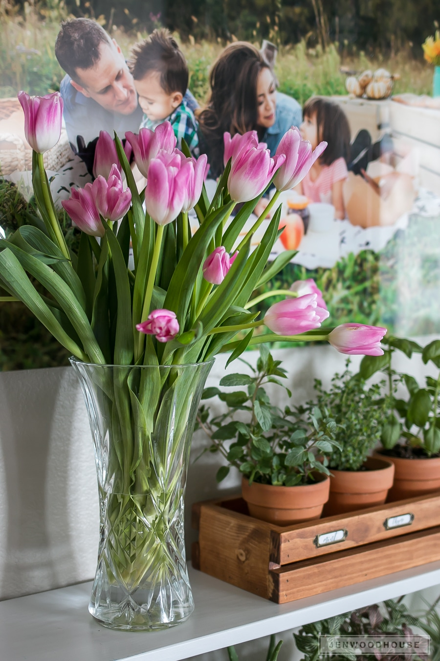 Decorate for Spring by adding a vase of tulips to your shelf