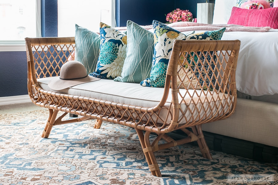 Absolutely love this rattan bench at the end of the bed