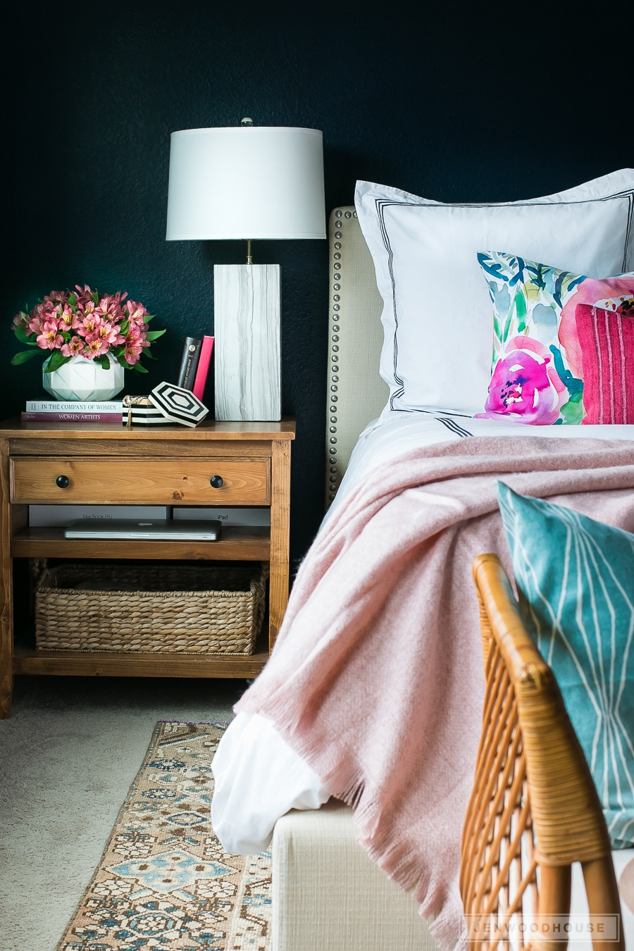 Add simple touches of Spring to your master bedroom by adding floral pillows and fresh flowers
