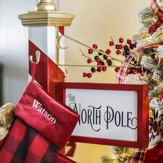 No mantel? No problem! Make this DIY Christmas stocking holder and hang your stockings in a fun and festive way! No mantel necessary!