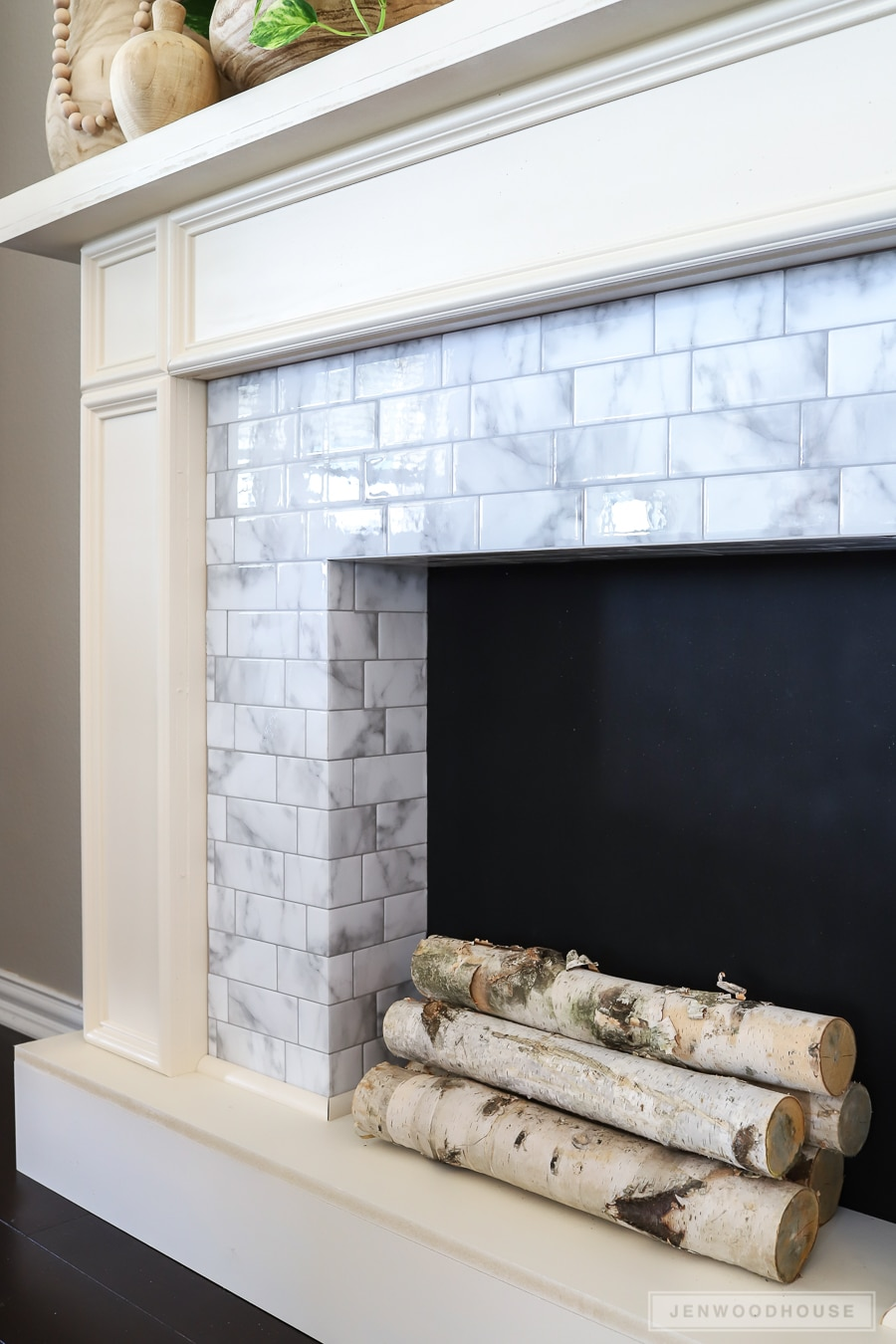 DIY Faux Fireplace Featuring Smart Tiles Adhesive Tiles - no messy grout! No fancy tools!