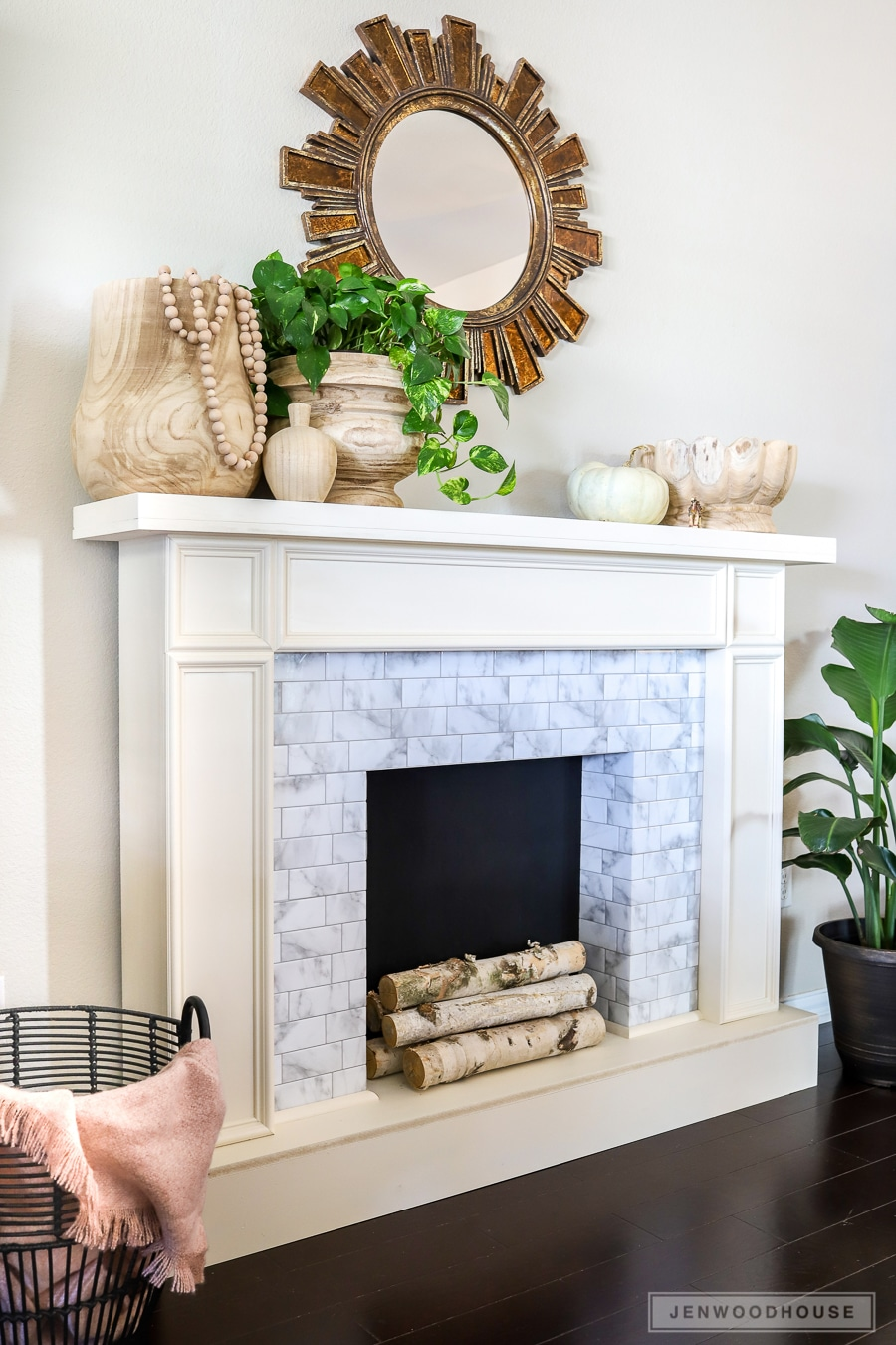 Build a DIY faux fireplace with adhesive tiles! Plans by Jen Woodhouse
